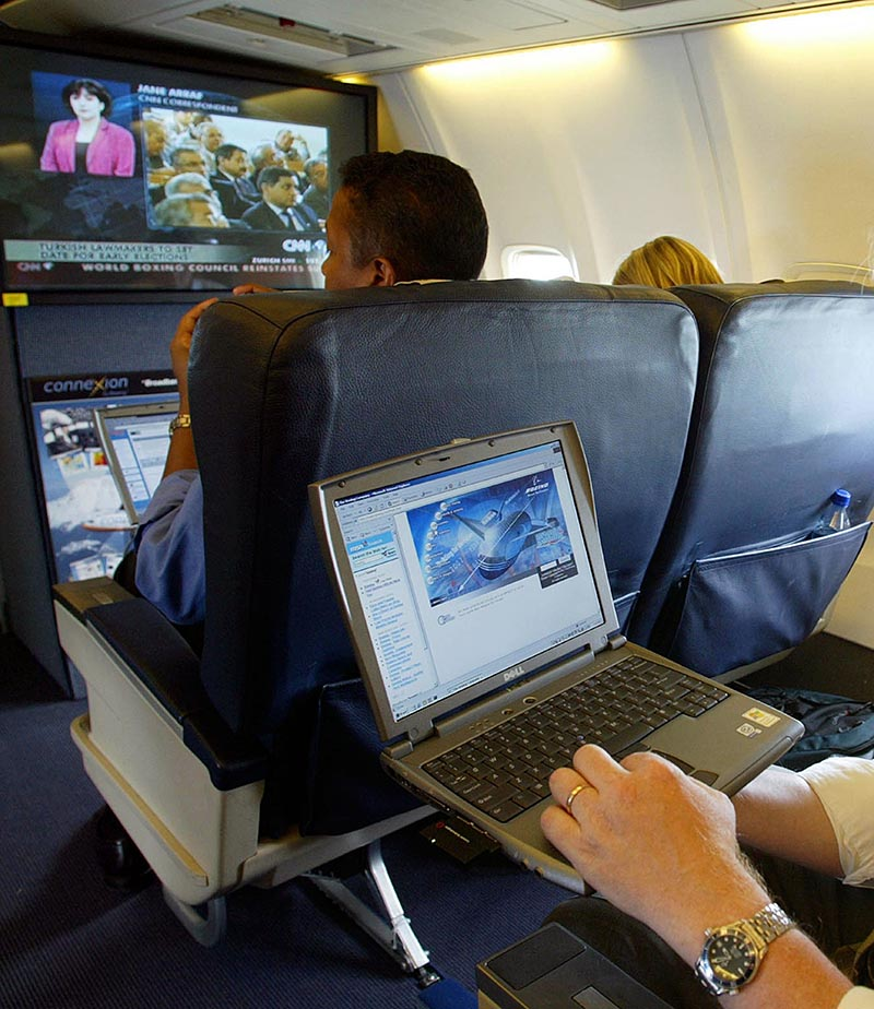 FILE - A laptop is used on a plane, on July 29, 2002. Britain's government on Tuesday March 21, 2017 banned electronic devices in the carry-on bags of passengers traveling to the UK from six countries, following closely on a similar ban imposed by the United States. Photo: Chris Ison/PA via AP