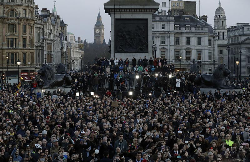 Crowds gather at a vigil for the victims of Wednesday's attack, at Trafalgar Square in London, on Thursday, March 23, 2017. The Islamic State group has claimed responsibility for an attack by a man who plowed an SUV into pedestrians and then stabbed a police officer to death on the grounds of Britain's Parliament. Photo: AP