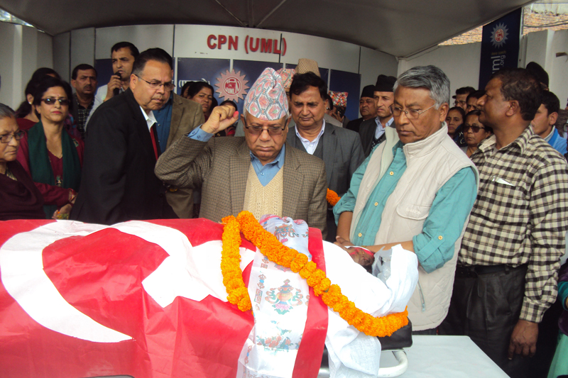 CPN-UML senior leader Madhav Kumar Nepal pays final tribute to the party's lawmaker Dulari Devi, in Kathmandu, on Friday, March 24, 2017. Photo: RSS
