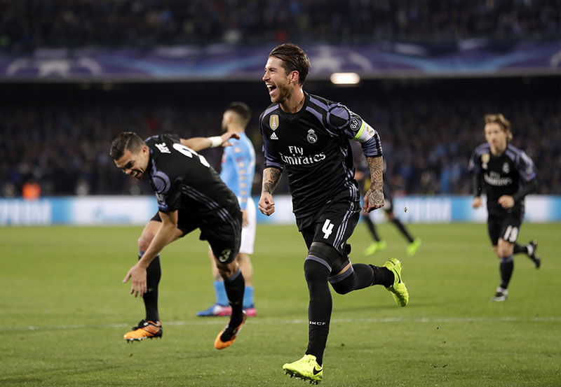 Real Madrid's Sergio Ramos celebrates after scoring his side's second goal during the Champions League round of 16, second leg, soccer match between Napoli and Real Madrid at the San Paolo stadium in Naples, Italy, on Tuesday, March 7, 2017. Photo: AP