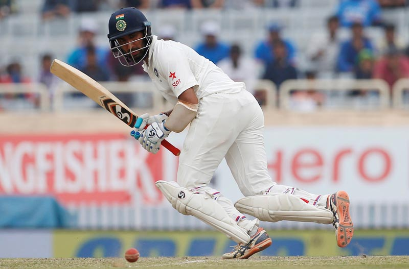India's Cheteshwar Pujara plays a shot. Photo: Reuters