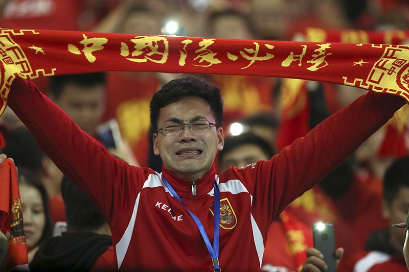 China soccer fans celebrate their team's 1-0 win over South Korea in the 2018 World Cup qualifier match in Changsha in central China's Hunan Province on Thursday, March 23, 2017. China won 1-0. Photo: Color China Photo via AP