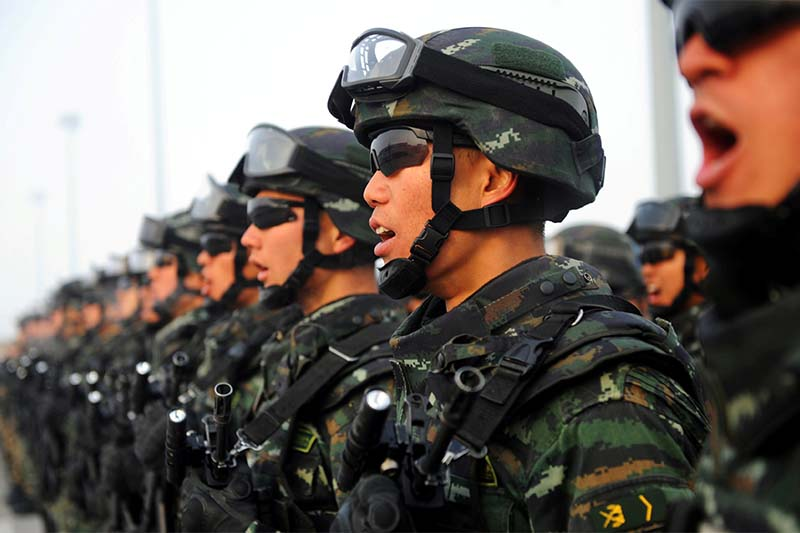 Paramilitary policemen stand in formation as they take part in an anti-terrorism oath-taking rally, in Kashgar, Xinjiang Uighur Autonomous Region, China, on February 27, 2017. Photo: Stringer via Reuters/File