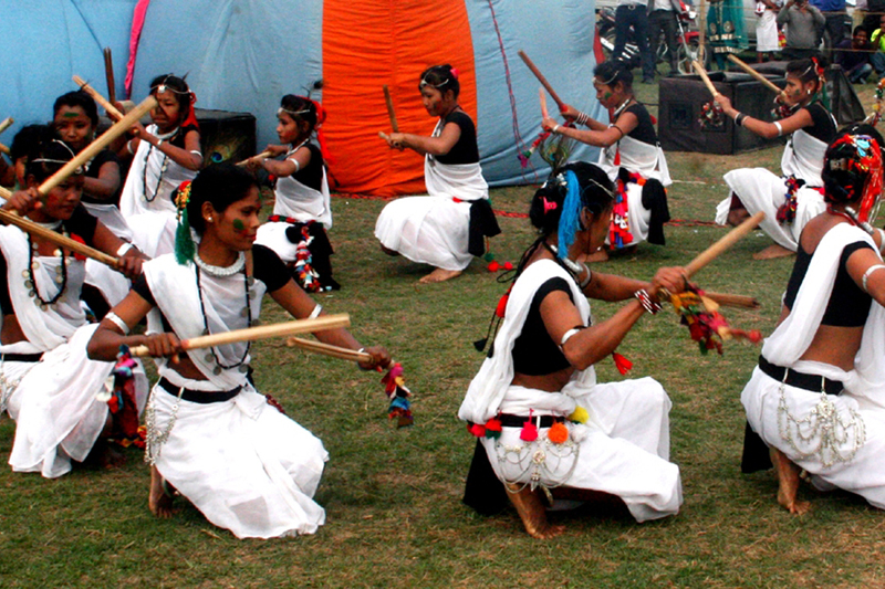 Tharu women dance at a function organised to celebrate Phaguwa festival in Sauraha of Chitwan district on Sunday, March 12, 2017. Photo: RSS