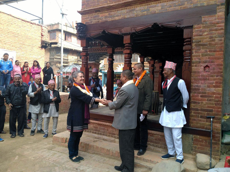 Representative of the Nepal Earthquake Relief Fund Heidelberg, Germany, Christiane Brosius (left) hands over the key of the recently reconstructed Lunchhen Nani Phalcha to chief of the Chabahal Community Association, Shyam Gopal Maharjan in Chabahal, Tangal of Patan on Thursday, March 23, 2017. Photo Courtesy: Padma Sundar Maharjan