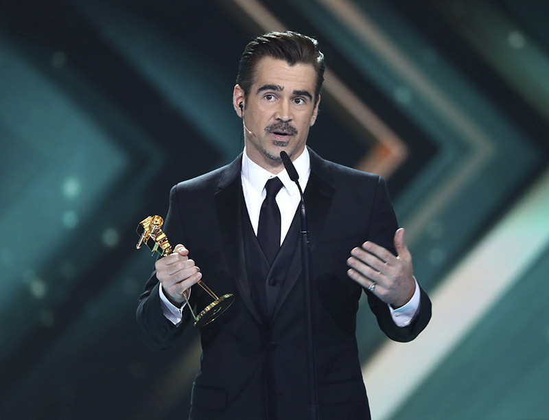 Actor Colin Farrell receives the best international actor award at the 52nd Golden Camera film & TV awards 2017 in Hamburg, Germany, Saturday March 4, 2017. (Christian Charisius/pool via AP)