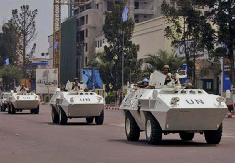 UN troops in armored vehicles drive through the streets of Kinshasa, Congo, on Monday, August 21, 2006. Photo: AP