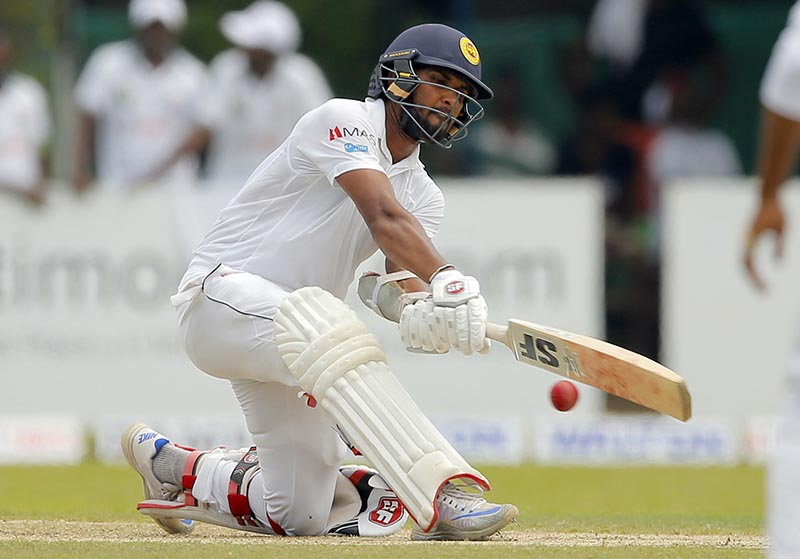 Sri Lankan batsman Dinesh Chandimal plays a shot against Bangladesh on day two of their second test cricket match in Colombo, Sri Lanka, Thursday, March 16, 2017. Photo: AP