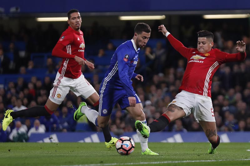 Chelsea's Eden Hazard in action with Manchester United's Marcos Rojo. Photo: Reuters