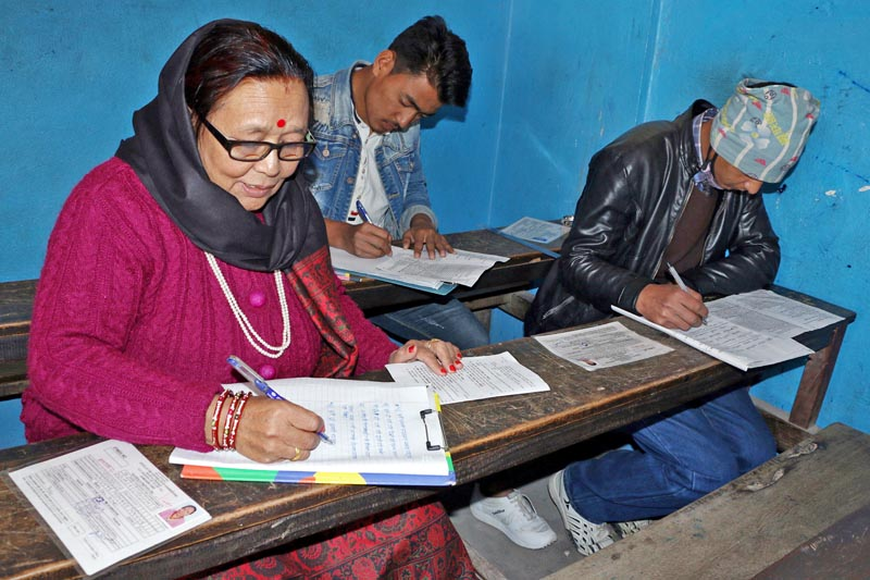An elderly woman is seen attending Secodary Education Examinations in Bhaktapur district, on Sunday, March 19, 2017. Photo: RSS
