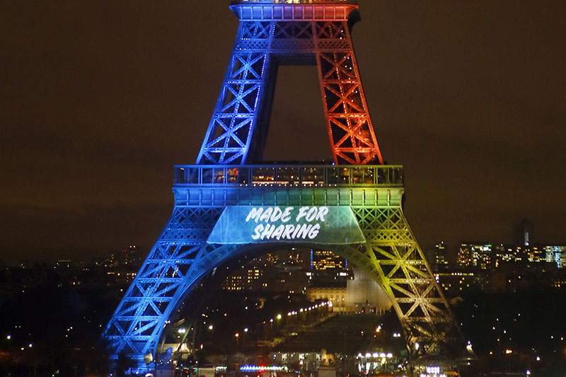 The Eiffel Tower is lit up with colors during the launch of its campaign as candidate for the 2024 Olympic summer games in Paris, on  February 3, 2017. Photo: AP