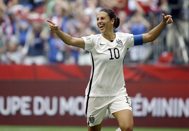 FILE - Carli Lloyd of the U.S celebrates scoring her third goal against Japan during the first half of the FIFA Women's World Cup soccer championship in Vancouver, British Columbia, Canada, on July 5, 2015.  Photo: AP