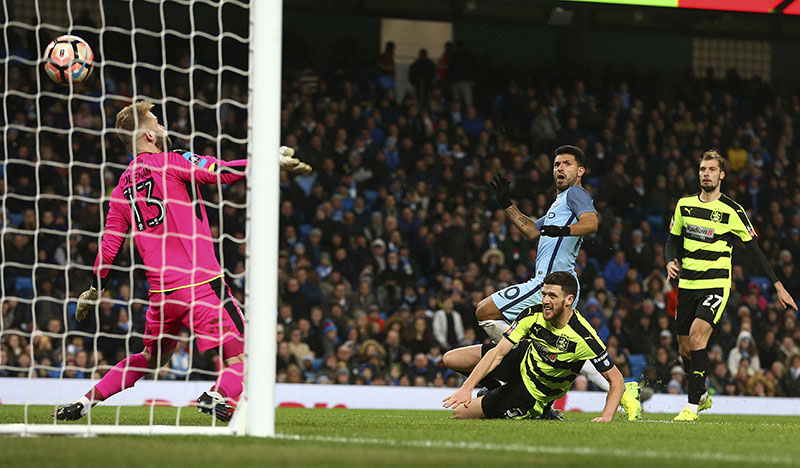 Manchester City's Sergio Aguero (centre) scores his side's fourth goal during the English FA Cup soccer match between Manchester City and Huddersfield Town at the Etihad stadium in Manchester, on Wednesday, March 1, 2017. Photo: AP