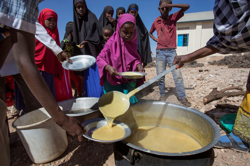 Children receive a meal at a school through the World Food Programme (WFP) in the drought-hit Baligubadle village near Hargeisa, the capital city of Somaliland, on March 15, 2017. Photo: International Federation of Red Cross and Red Crescent Societies  via Reuters