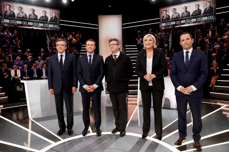 French presidential election candidates (left to right) Francois Fillon, Emmanuel Macron, Jean-Luc Melenchon, Marine Le Pen and Benoit Hamon, pose before a debate organised by French private TV channel TF1 in Aubervilliers, outside Paris, France, on March 20, 2017. Photo: Reuters
