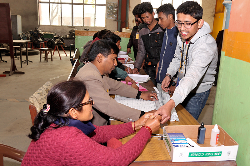 Students participate in voting during the Free Student Union elections held at Thapathali Engineering Campus, in Kathmandu, on Wednesday, March 1, 2017. Photo: RSS