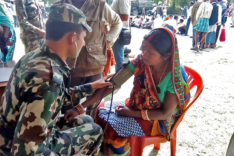 An army doctor examines a woman during the free intensive health camp, jointly organised by the Ministry of Health and the Nepal Army, at Gaur of Rautahat district, on  Tuesday, March 21, 2017. Photo: Prabhat Kumar Jha