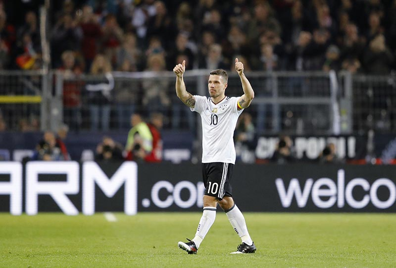 Germany's Lukas Podolski leaves the pitch during the friendly football match between Germany and England, which is Podolski's last mach in the national team, in Dortmund, Germany, on Wednesday, March 22, 2017. Photo: AP