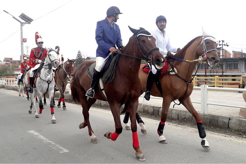 Army personnel ride horses on their way to Tundikhel for the preparations of upcoming Ghode Jatra (Horse Carnival) festival in Kathmandu, on Monday, March 20, 2017. Photo: RSS
