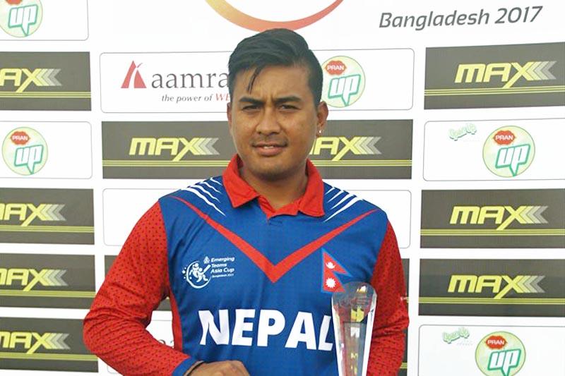 Gyanendra Malla pose for a photo after receiving Man of the Match trophy. Courtesy: Raman Shiwakoti