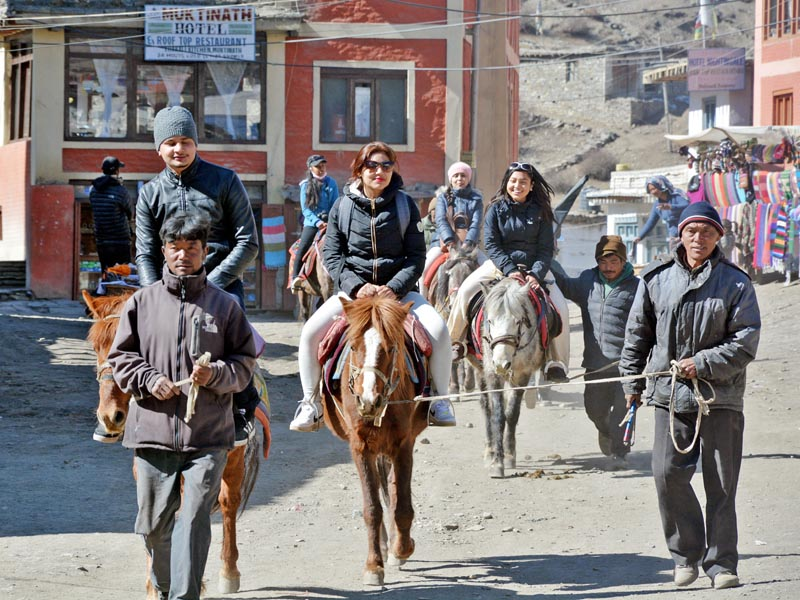 Tourists make their way to the Muktinath Temple in Mustang district on horses on Wednesday, March 15, 2017. Photo: RSS