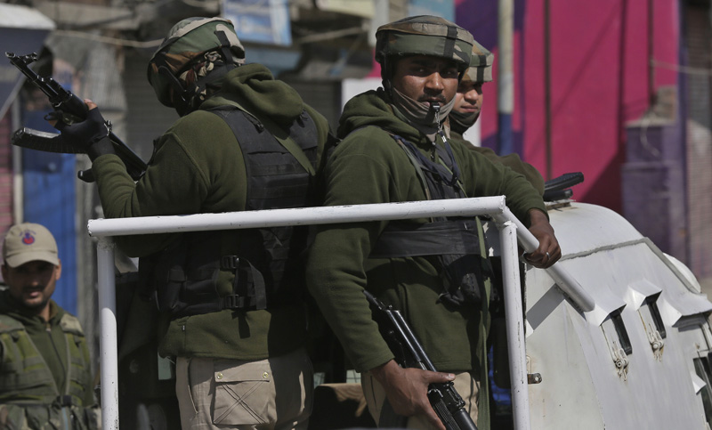 Indian paramilitary soldiers guard outside the police headquarters in Srinagar, India, Sunday, March 5, 2017. Photo: AP