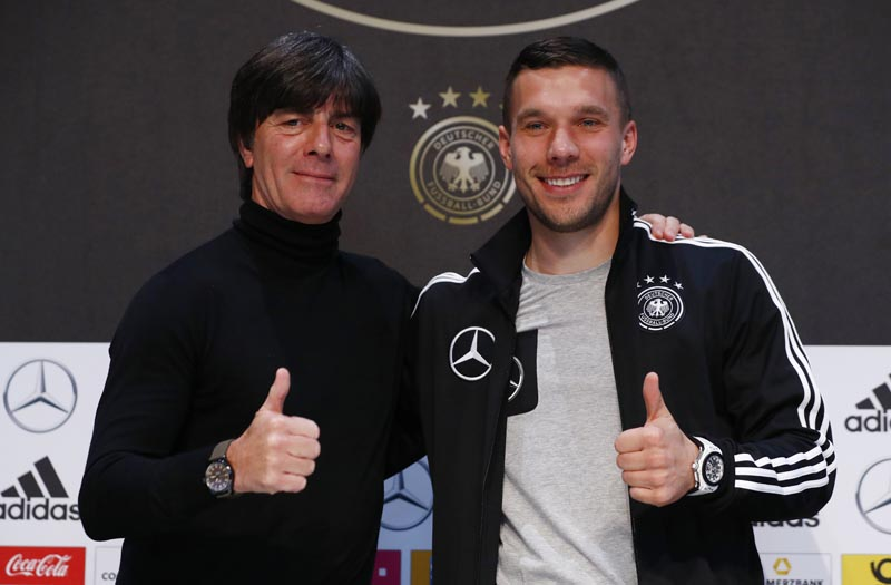 Germany's coach Joachim Loew and Lukas Podolski pose after the press conference. Photo: Reuters