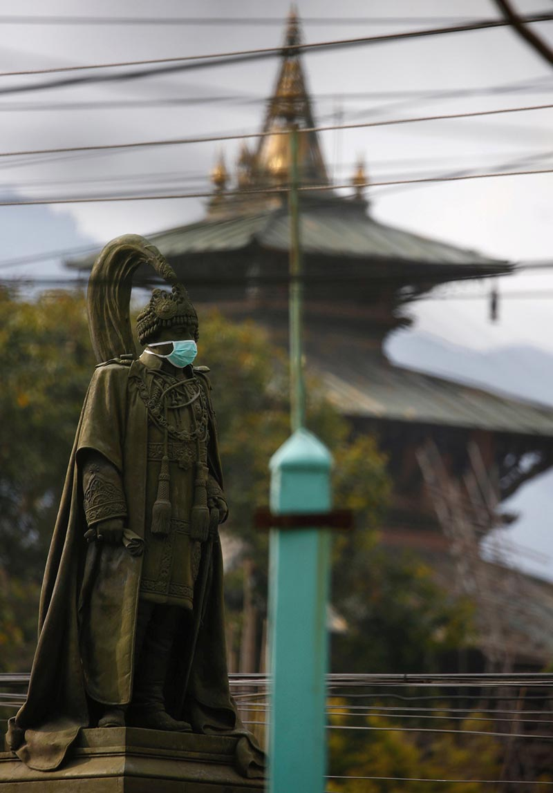A mask is seen on a statue of Juddha Shumsher Jang Bahadur Rana  on a polluted day in Kathmandu, on March 19, 2017. Juddha Shumsher Rana was a prime minister during the Rana dynasty. Photo: Reuters