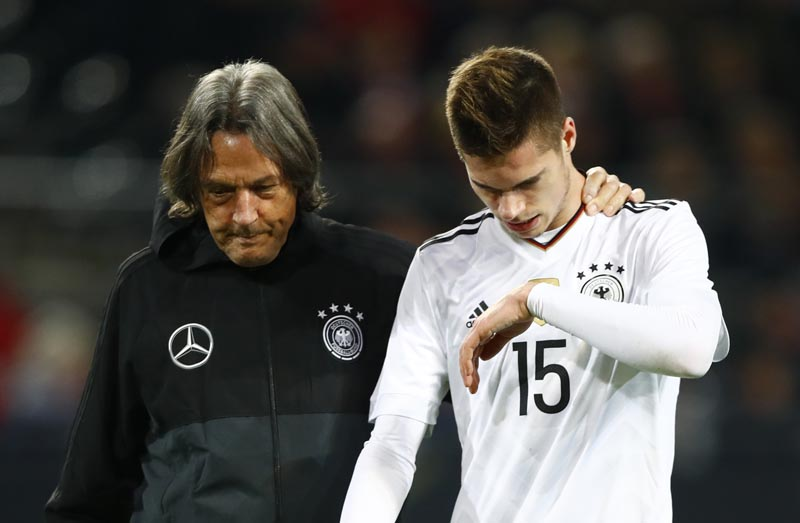 Germany's Julian Weigl receives medical attention. Photo: Reuters