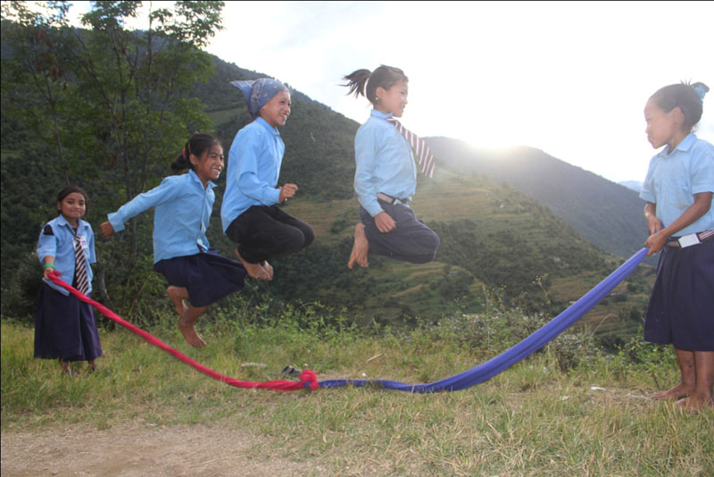 Students play a jumping game while returing to their home after school at Kakri VDC in Rukum district, on Friday, March 10, 2017. Photo: RSS