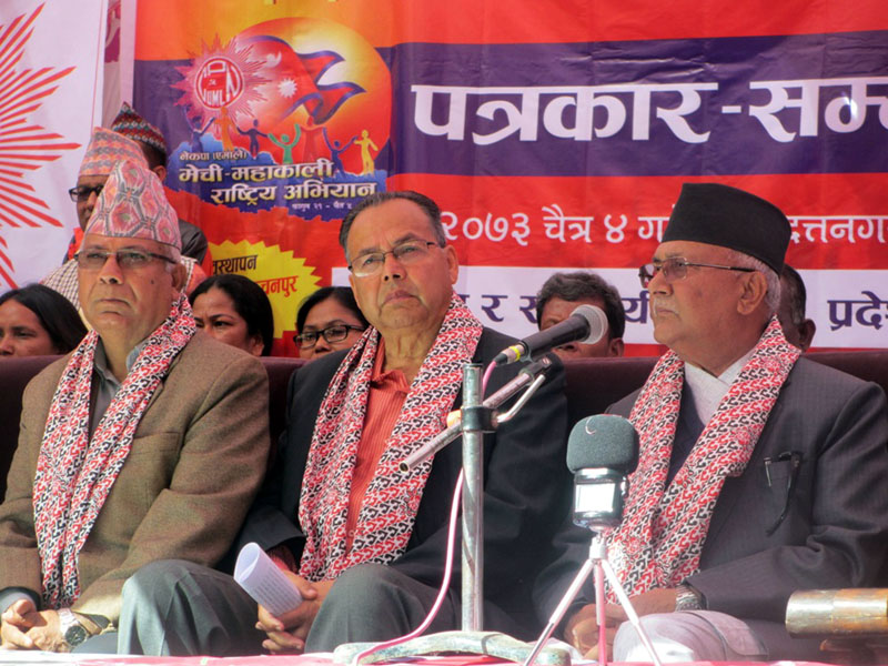 FILE: CPN-UML Chairman KP Sharma Oli (right), senior leaders Jhalanath Khanal (centre) and Madhav Kumar Nepal attend a press meet organised on the final day of the Mechi-Mahakali Campaign in Bhimdattanagar, Kanchanpur district on Friday, March 17, 2017. Photo: RSS
