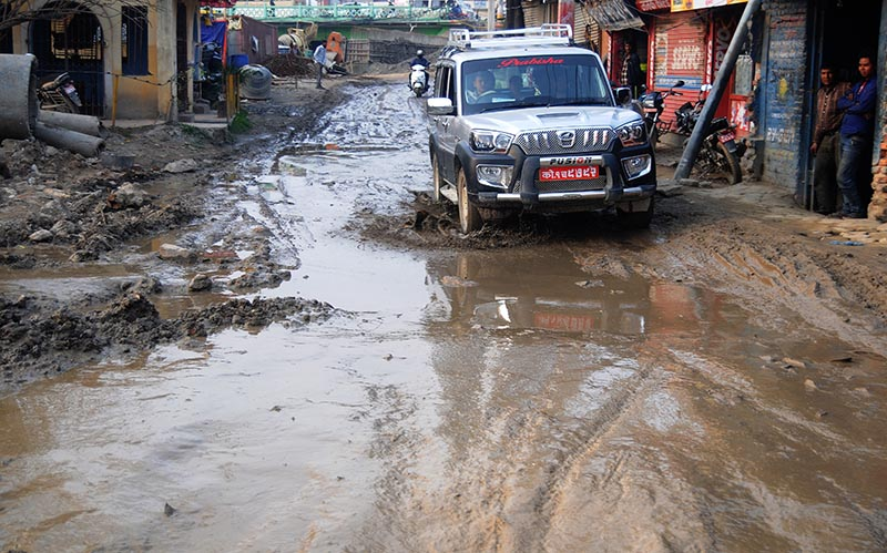 Vehicles passing through a muddy road in Buddhanagar, Kathmandu, on Thursday, March 30, 2017. Delay in upgradation of roads in the Valley has caused inconvenience to public. Photo: Balkrishna Thapa Chhetry/THT