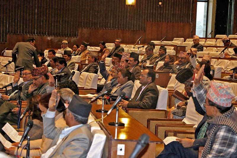 Lawmakers show their support to hold deliberations on a bill on provision of facilities to the former office-bearers at the Legislature-Parliament meeting, in Kathmandu, on Tuesday, March 14, 2017. Photo: RSS