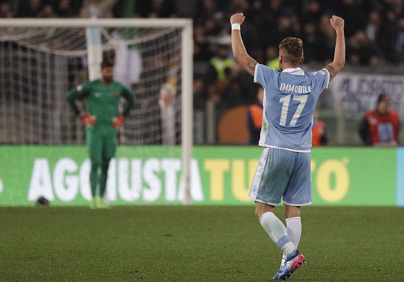 Lazio's Ciro Immobile celebrates after scoring during an Italian Cup, first-leg, semifinal soccer match between Lazio and Roma, at the Rome Olympic stadium, on Wednesday, March 1, 2017. Photo: AP
