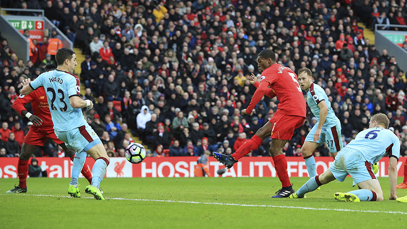 Liverpool's Georginio Wijnaldum scores his side's first goal during the English Premier League soccer match between Liverpool and Burnley at Anfield, Liverpool, England, on Sunday, March 12, 2017. Photo: Peter Byrne/PA via AP