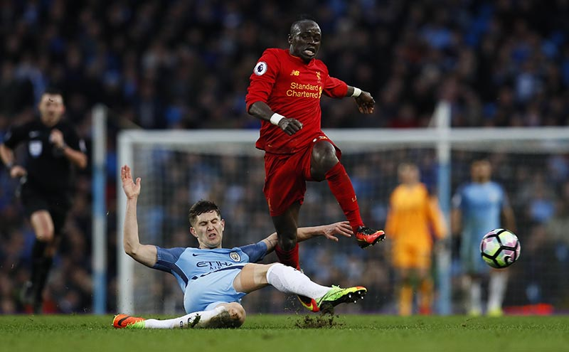 Manchester City's John Stones in action with Liverpool's Sadio Mane.Photo: Reuters