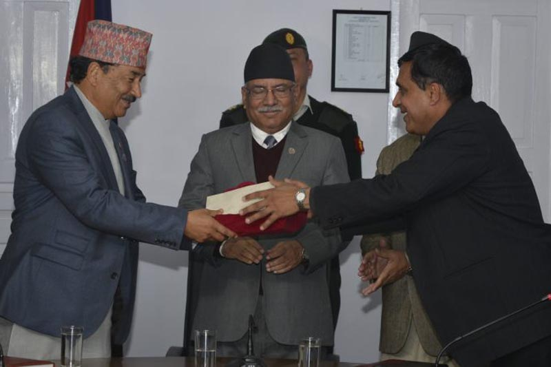 Local Bodies Restructuring Commission Chairman Balananda Paudel submits the Commission report to Deputy Prime Minister Kamal Thapa in the presence of Prime Minister Pushpa Kamal Dahal, in Kathmandu, on Monday, March 13, 2017. Photo: PM's Secretariat