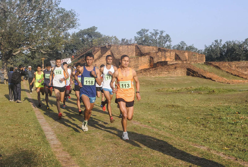 Homlal Shrestha (118) running along with other participants during the third Lumbini Peace Marathon in Lumbini on Sunday, March 12, 2017. Photo: THT