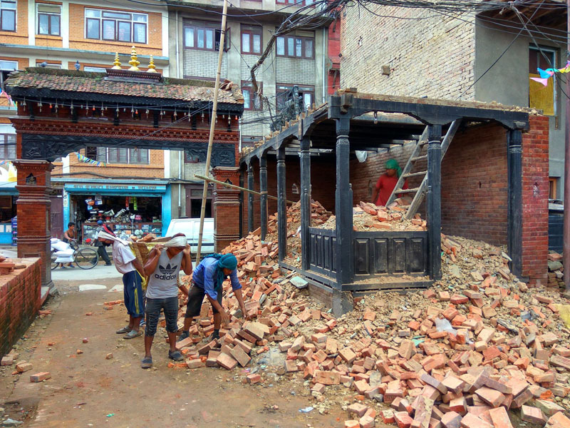 Lunchhen Nani Phalcha, destroyed by the Gorkha Earthquake 2015, of Tangal, Patan is being dismantled for beginning its reconstruction in August 2016. Photo Courtesy: SAI Help Nepal