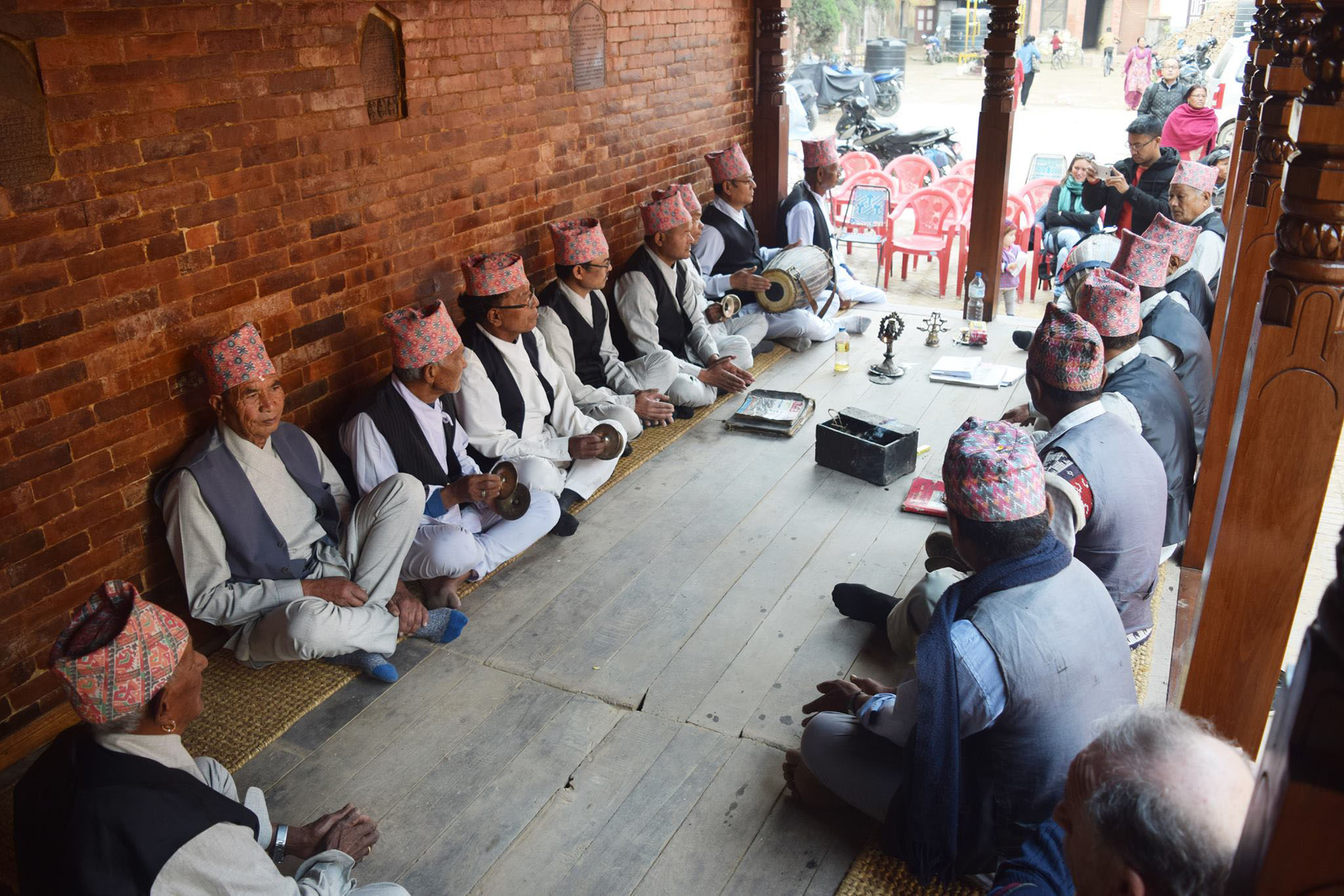 Locals sing hymns in the recently reconstructed pati (inn), Lunchhen Nani Phalcha, in Chabahal, Tangal of Patan on Thursday, March 23, 2017. The pati was destroyed by the 2015 Gorkha Earthquake. Photo Courtesy: Padma Sundar Maharjan