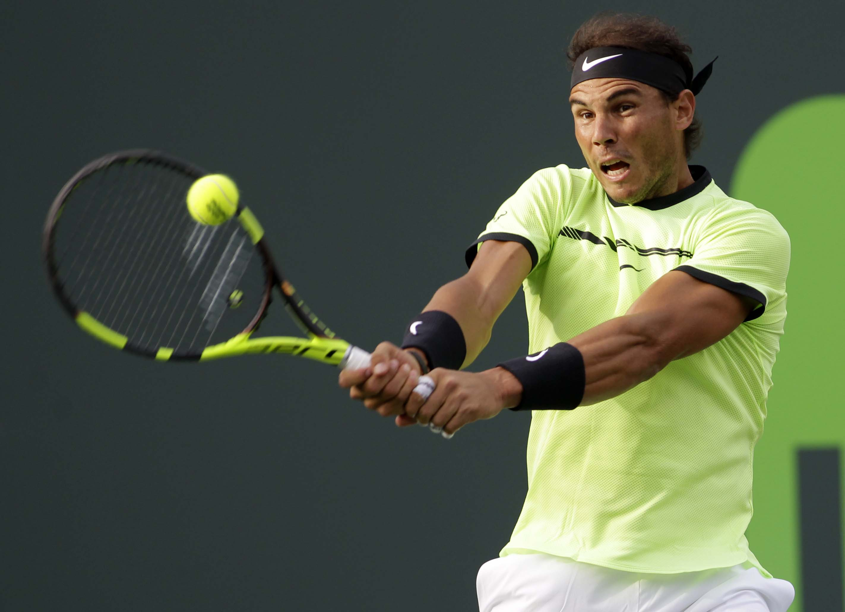 Rafael Nadal, of Spain, returns the ball to Dudi Sela,u00a0of Israel, during the Miami Open tennis tournament, in Key Biscayne, Florida, on Friday, March 24, 2017. Photo: AP