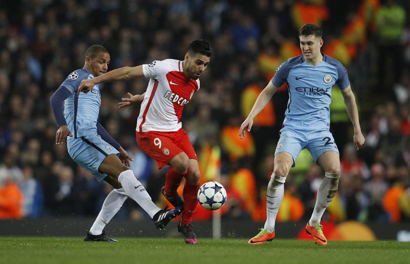 Monaco's Radamel Falcao in action with Manchester City's Fernando and John Stones. Photo: Reuters