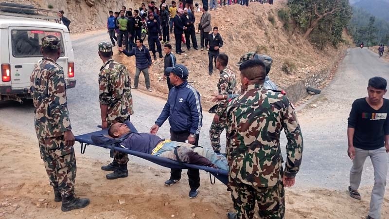 Nepal Army personnel rescue an injured passenger from a bus accident site in Khalanga of Jajarkot district, on Thursday, March 9, 2017. Photo: Dinesh Kumar Shrestha