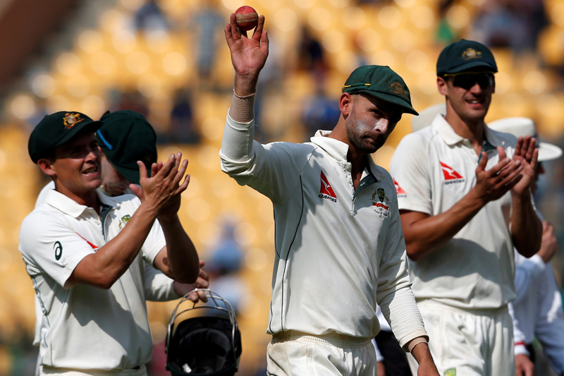Australia's Nathan Lyon acknowledges the crowd as he walks off the ground. Photo: Reuters