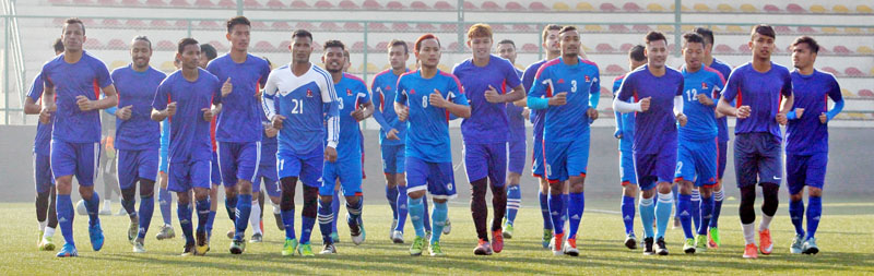 Nepal's National Football team players warm up at  ANFA Complex in Satdobato, in Lalitpur, on Friday, March 10, 2017. Courtesy: ANFA