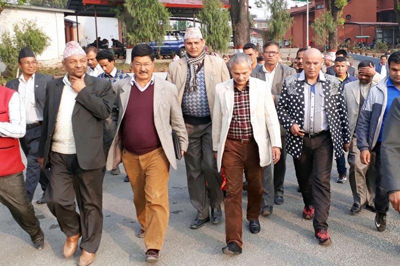 FILE: Naya Shakti Party Nepal coordinator Baburam Bhattarai along with other leaders walks towards the PM's residence to submit a memorandum to the Prime Minister Pushpa Kamal Dahal, in Baluwatar, Kathmandu, on Thursday, March 30, 2017. Courtesy: NSPN/Twitter