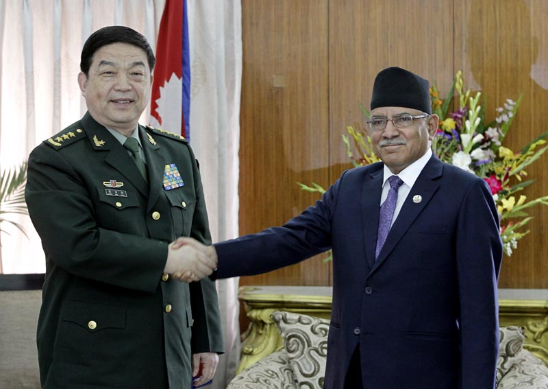 Nepali Prime Minister Pushpa Kamal Dahal shakes hands with Chinese Defence Minister Chang Wanquan in Kathmandu, on Thursday, March 23, 2017. Photo: AP