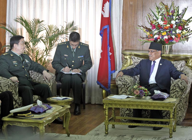Nepal's Prime Minister Pushpa Kamal Dahal talks to Chinese Defense Minister Chang Wanquan, in Kathmandu, on Thursday, March 23, 2017. Chang is on a three-day official visit to Nepal. Photo: AP