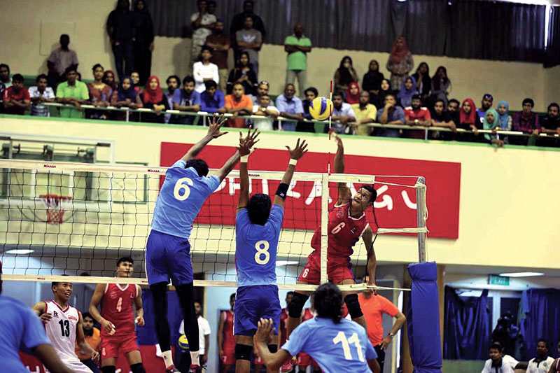 Nepalu2019s Dhana Bahadur Bhatta jumps for a spike against Maldives during their AVC Central Zone Volleyball Tournament match in Male on Friday, March 24, 2017. Photo Courtesy: PSM Sports