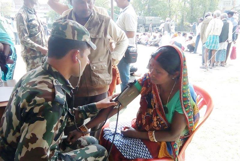 A Nepali Army medic checking up a patient at a free intensive mobile camp jointly organised by the NA and Ministry of Health, in Gaur, Rautahat, on Tuesday, March 21, 2017. Photo: THT